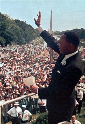 """In this Aug. 28, 1963 file photo, The Rev. Martin Luther King Jr. waves to the crowd at the Lincoln Memorial for his """"I Have a Dream"""" speech during the March on Washington. The march was organized to support proposed civil rights legislation and end segregation."""