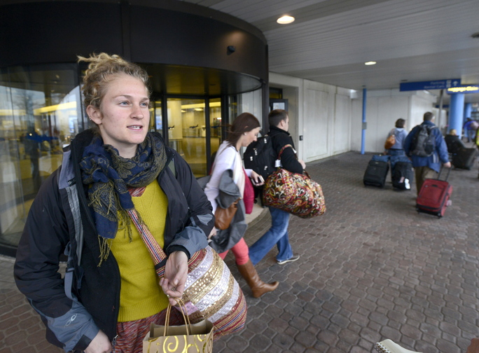 Echo Presgraves traveled from Baltimore to spend the holiday on Peaks Island and was among travelers at the Portland International Jetport on Wednesday to find schedules were on time.