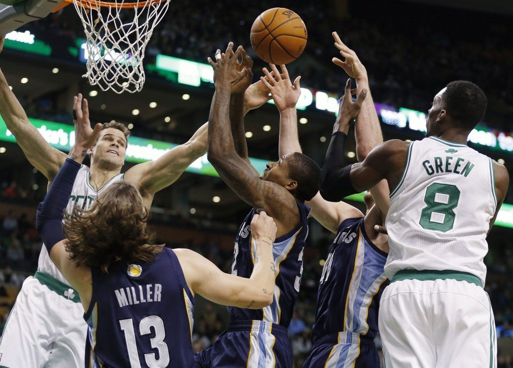 Boston Celtics' Kris Humphries, left, and Jeff Green (8) battle for a rebound with Memphis Grizzlies' Mike Miller (13), Ed Davis, center, and Kosta Koufos, second from right, in the first quarter o in Boston on Wednesday.