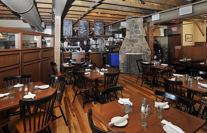 This Sept. 19, 2013 file photo shows the main dining room at Boone's Fish House & Oyster Room on the Portland waterfront, where a fire started early this morning in the fireplace, damaging floorboards and causing the restaurant to be closed temporarily.