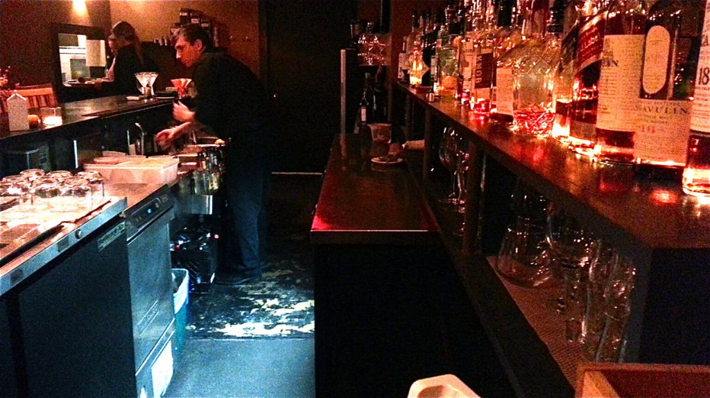 The well-stocked lounge serves a variety of cocktails and specialty drinks.