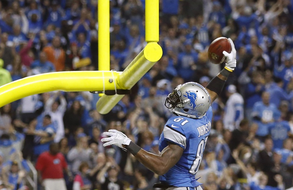 Detroit's Calvin Johnson slam-dunks the ball after catching a TD pass, much the way the Lions slam-dunked the suddenly very mediocre Packers on Thanksgiving.