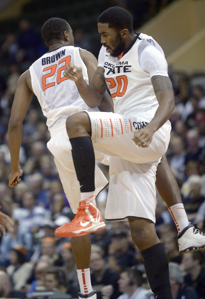 Markel Brown, left, and Michael Cobbins of Oklahoma State celebrate during a first-half timeout Thursday. Too early to celebrate? Maybe, but the Cowboys went on to beat Purdue.