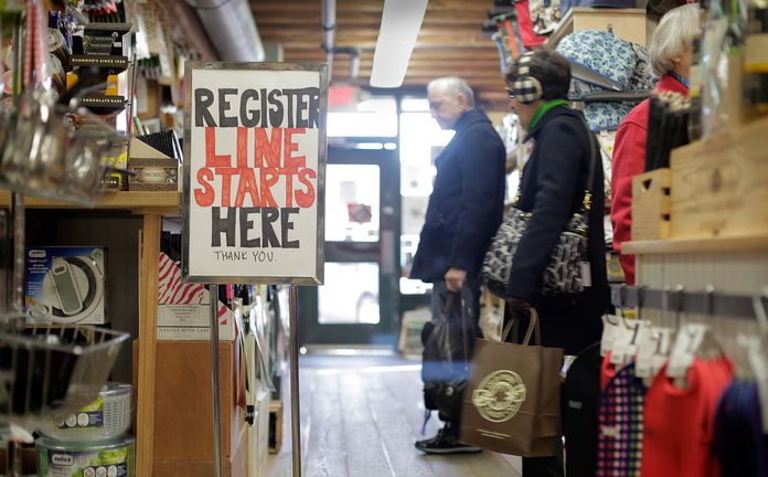 Shoppers browse at LeRoux Kitchen on Commercial Street in Portland on Friday.