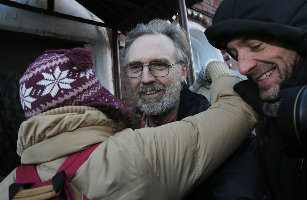 Greenpeace International activist Colin Russell of Australia, center, is greeted as he leaves a jail after being freed on bail in St.Petersburg, Russia, on Friday. Russell is the last one of the 30 people to be granted bail of those on board the Arctic Sunrise ship who were arrested during a Greenpeace protest in Arctic waters. The charges against the accused protesters still stand.