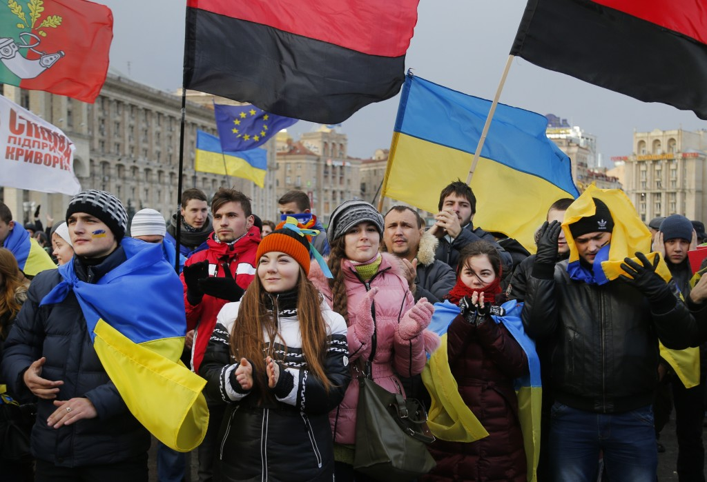 Demonstrators protest during a rally in support of Ukraine's integration with the European Union in the center of Kiev, Ukraine, Friday Nov. 29, 2013. The European Union extended its geopolitical reach eastward on Friday by sealing association agreements with Georgia and Moldova, but blamed Russia for missing out on a landmark deal with Ukraine. (AP Photo/Sergei Grits)