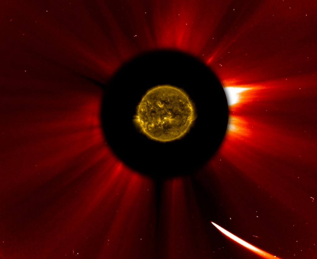 In a composite image provided by NASA, Comet ISON nears the sun in an image captured at 10:51 a.m. Eastern Standard Time on Thursday, Nov. 28, 2013. The sun was imaged by NASA's Solar Dynamics Observatory, and an image from ESA/NASA's Solar and Heliospheric Observatory shows the solar atmosphere, the corona. Scientists are studying spacecraft images to find out whether a small part ISON survived its close encounter with the sun. (AP Photo/ESA&NASA SOHO/SDO)
