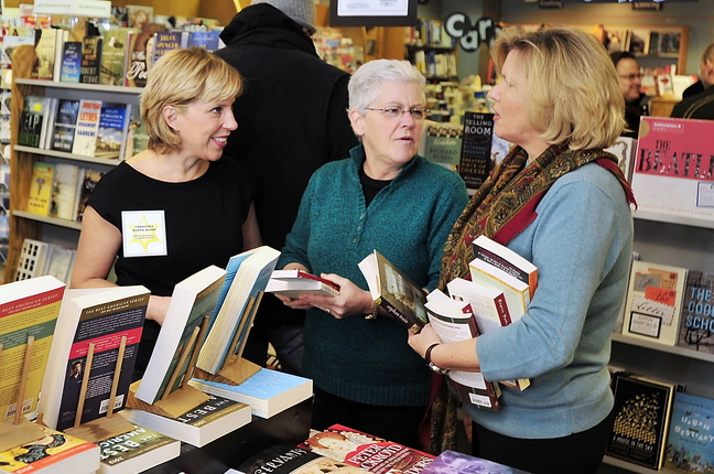 """Jeanne Hulit, acting administrator of the Small Business Administration, right, and Gina McCarthy, administrator of the EPA, middle, chat with Christina Baker Kline, author of """"Orphan Train,"""" at Longfellow Books in Portland on Small Business Saturday."""