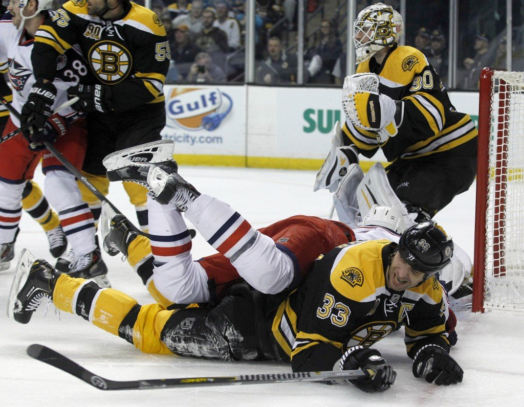 Boston Bruins defenseman Zdeno Chara goes to the ice as he also takes out Columbus Blue Jackets left wing Nick Foligno during the Bruins' 3-1 win Saturday at Boston.