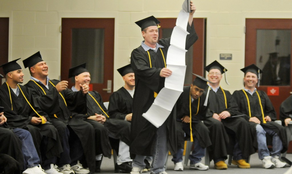 Maine State Prison inmate Steven Clark holds up a speech about everyone he wanted to thank Monday after he and 13 other men incarcerated at the Warren prison received their diplomas from the University of Maine at Augusta.