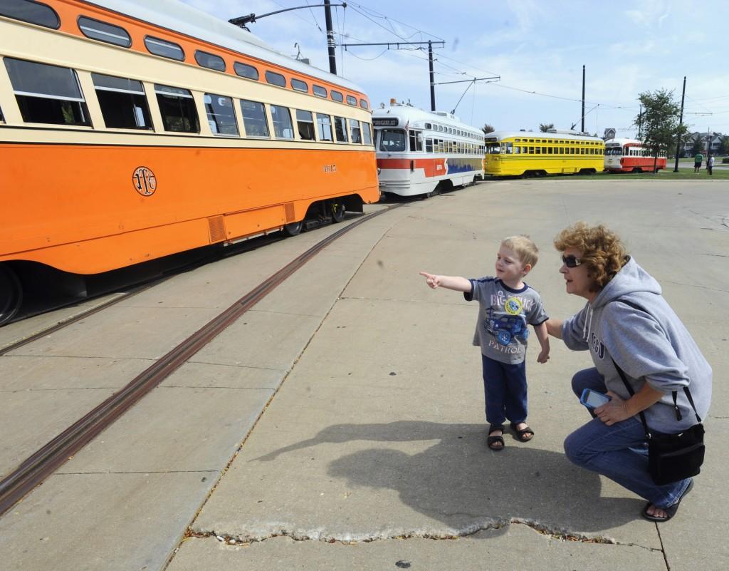 Johnathan Sainski, 2, points out his favorite streetcar to his grandmother Anna Sainski during Kenosha Streetcar Day outside the Joseph McCarthy Transit Center in Kenosha, Wis.