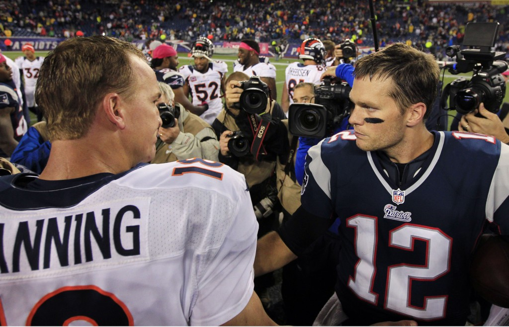 In this Oct. 7, 2012 file photo, Denver Broncos quarterback Peyton Manning, left, and New England Patriots quarterback Tom Brady meet after the Patriots' 31-21 win in their NFL football game in Foxborough, Mass. (AP Photo/Steven Senne, File)