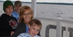 Karen Henigan Henick sits with her three children, Nicole Gelinas, back, Tyler Gelinas, left, and Connor Gelinas, front.