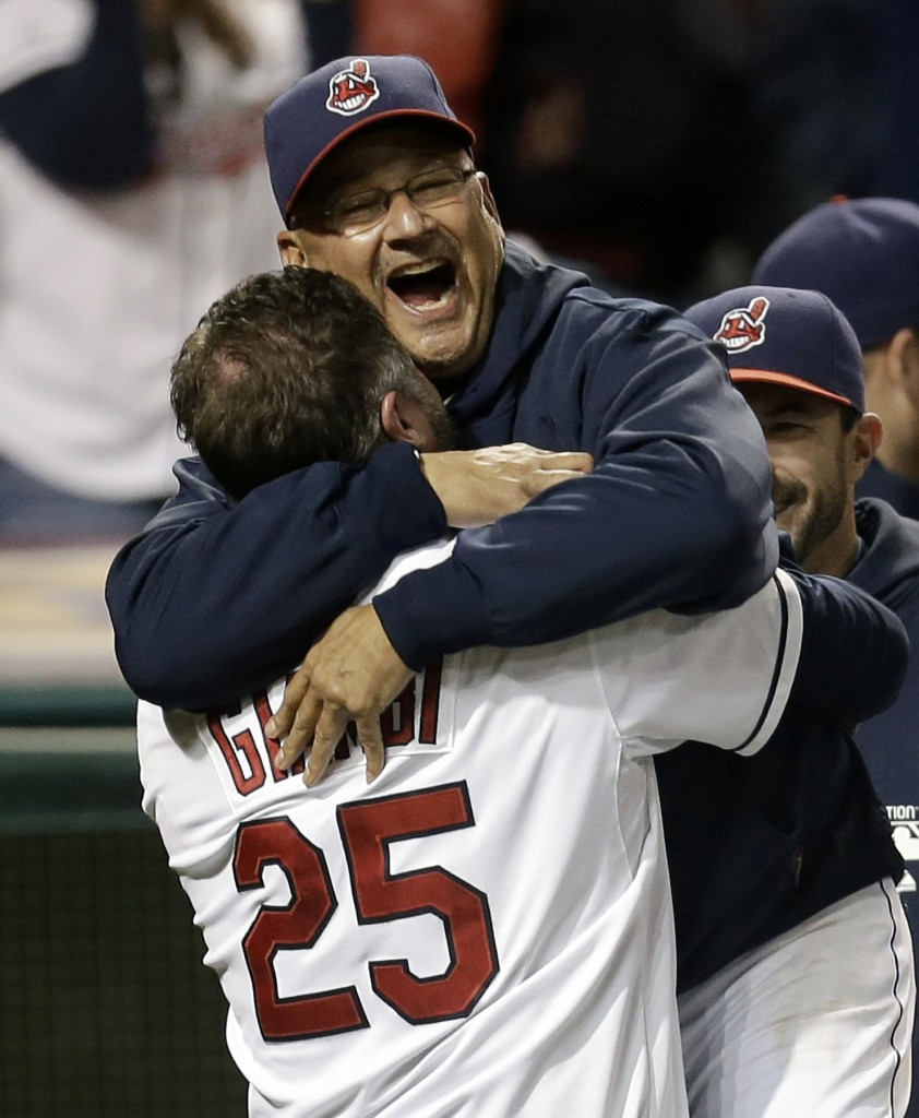In this Sept. 24, 2013, file photo, Cleveland Indians designated hitter Jason Giambi, left, picks up manager Terry Francona after Giambi hit a two-run home run off Chicago White Sox relief pitcher Addison Reed in the ninth inning of a baseball game in Cleveland. Francona was selected as the AL Manager of the Year on Tuesday, Nov. 12, 2013, by the Baseball Writers' Association of America.