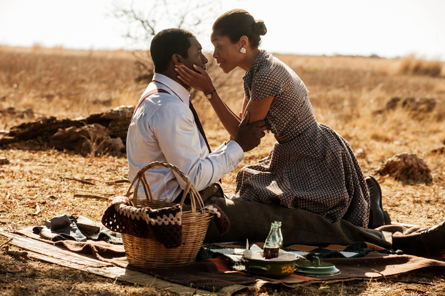 """This image released by The Weinstein Company shows Idris Elba, as Nelson Mandela, left, and Naomie Harris as Winnie Mandela in a scene from """"Mandela: Long Walk to Freedom."""