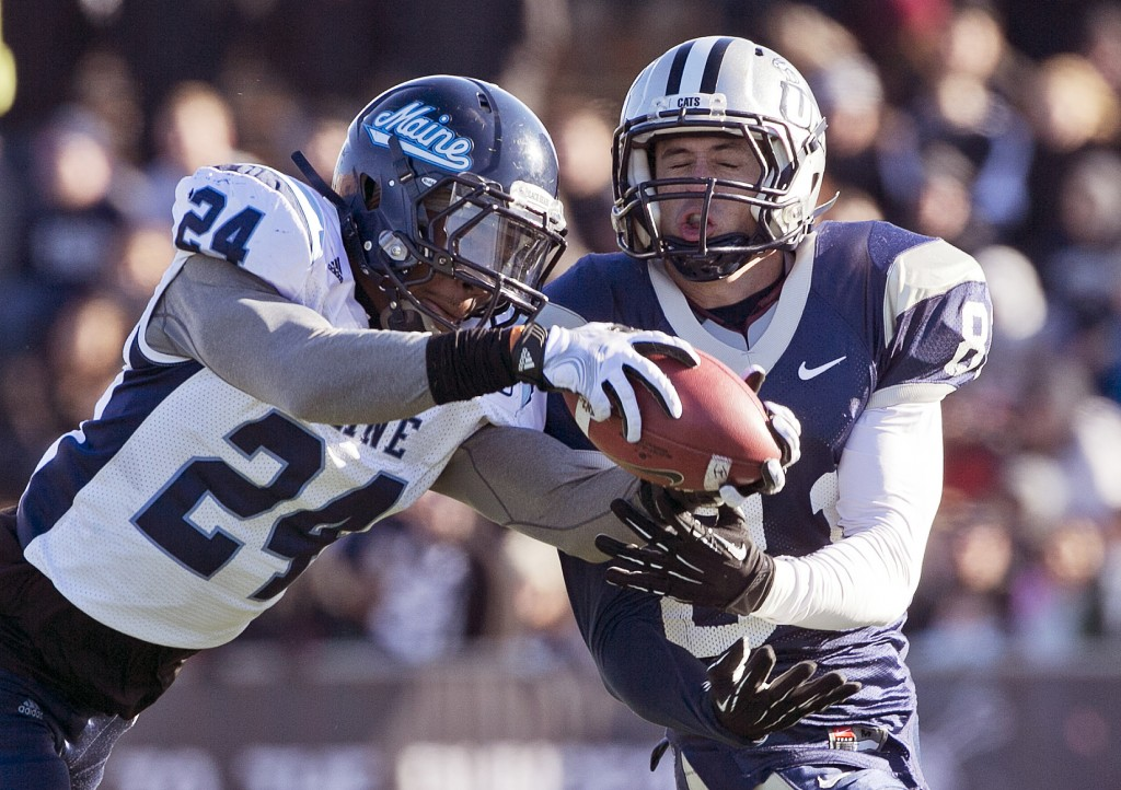 Maine defensive back Khari Al-Mateen breaks up a pass intended for New Hampshire wide receiver Jared Allison last season.