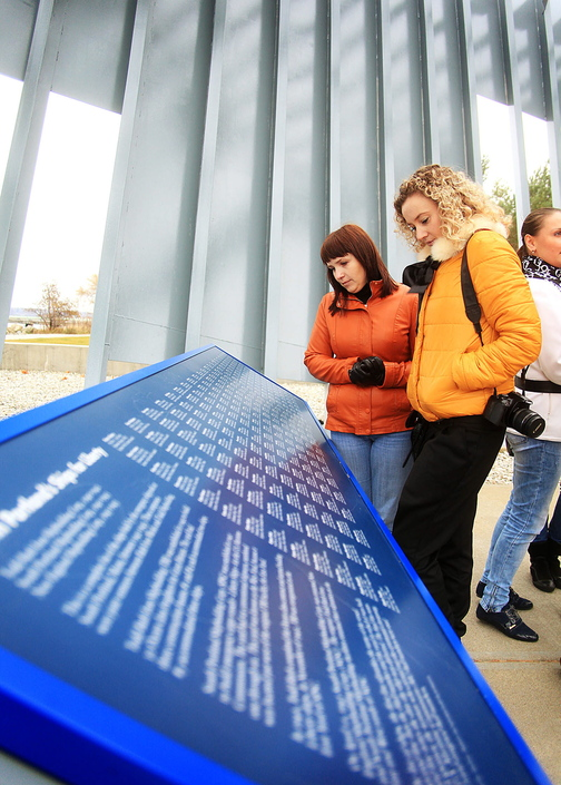 Vera Pigina, left, and Anna Ilina, both members of a visiting Russian delegation from Portland's sister city of Archangel, read the names of the ships built by the emergency shipyards between 1941 and 1945 while visiting the Liberty Ship Memorial at Bug Light Park in South Portland on Sunday.