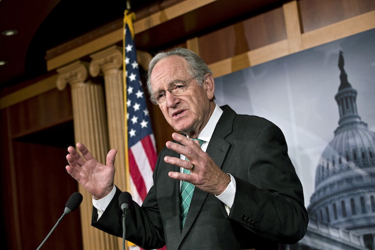Sen. Tom Harkin, D-Iowa, chairman of the Health, Education, Labor, and Pensions Committee, talks to reporters after the Senate cleared a major hurdle and agreed to proceed to debate a bill that would prohibit workplace discrimination against gay, bisexual and transgender Americans, at the Capitol in Washington, Monday, Nov. 4, 2013. The bipartisan vote increases the chances that the Senate will pass the bill by week's end, but its prospects in the Republican-led House are dimmer.