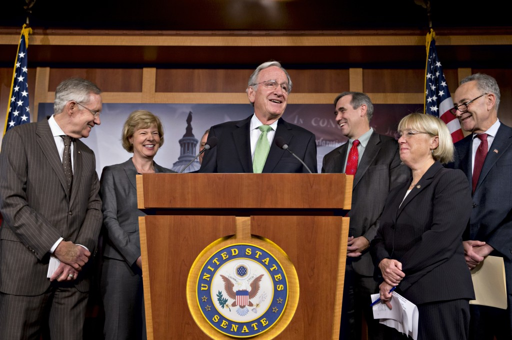 There were smiles all around as Democrats gathered after the Senate cut off debate to move toward a historic vote on legislation outlawing workplace discrimination against gay, bisexual and transgender Americans, on Capitol Hill in Washington on Thursday. From left are Senate Majority Leader Harry Reid, D-Nev., Sen. Tammy Baldwin, D-Wis., Sen. Tom Harkin, D-Iowa, Sen. Jeff Merkley, D-Ore., Sen. Patty Murray, D-Wash., Sen. Charles Schumer, D-N.Y.