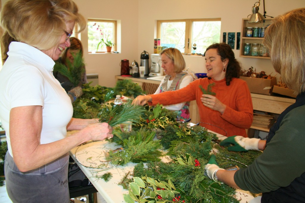 Wreath makers at a workshop at Lincoln Farm Studio in Falmouth get creative with greens, pods, cones and berries.