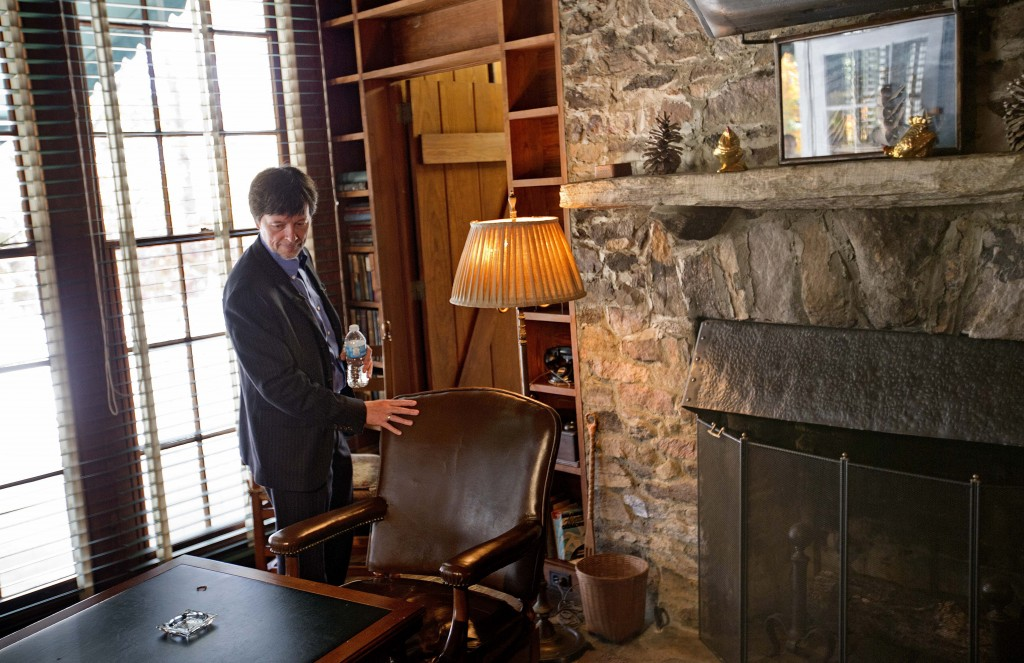 Documentary filmmaker Ken Burns, right, touches the chair where former President Franklin D. Roosevelt was sitting for a portrait when he died April 12, 1945 in his Georgia home, Saturday, Nov. 2, 2013, in Warm Springs, Ga. Burns along with several members of the Roosevelt family toured the home known as the Little White House Saturday used by Roosevelt as Burns previewed parts of his 14-hour film on the Roosevelt's.