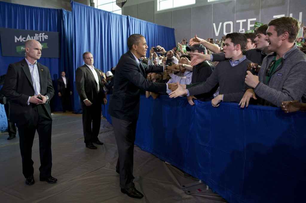 President Barack Obama is greeted by the crowd before speaking at a campaign event for Virginia Democratic gubernatorial candidate Terry McAuliffe at Washington-Lee High School in Arlington, Va. on Sunday, Nov. 3, 2013.