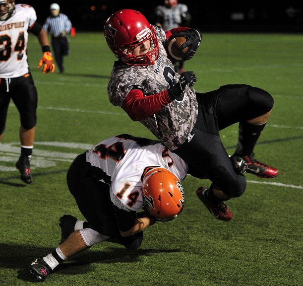 Zach Carriero of Scarborough is brought down by Corey Brown of Biddeford but not before gaining a first down Friday night during their Western Class A quarterfinal. Scarborough will take on top-ranked Bonny Eagle after scoring a 45-19 victory at home.