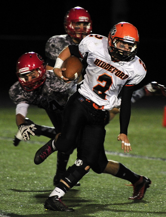 Biddeford's Corey Creeger breaks tackles to gain considerable yardage. Scarborough hosted Biddeford in Western Division A playoff football action Friday.