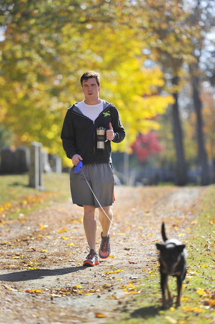 """Dustin Tucker walks his with dog Minnie in Portland's Evergreen Cemetery. """"I liked working here so much, I decided I should live here,"""" said Tucker, who grew up in Amarillo, Texas. """"Portland is a beautiful town, and I have a great circle of friends here."""""""