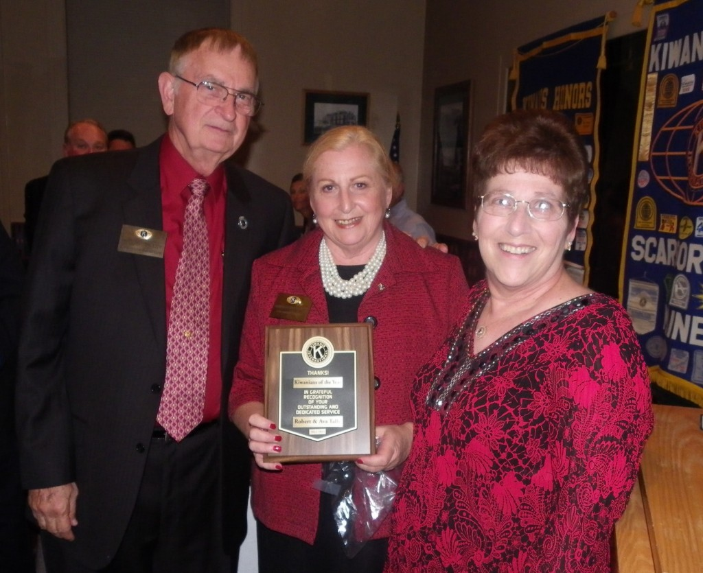 Outgoing Scarborough Kiwanis Club president Annalee Rosenblatt, center, awards Robert Talley and Ava Adams-Talley with the Kiwanian of the Year award for their contributions to the community.