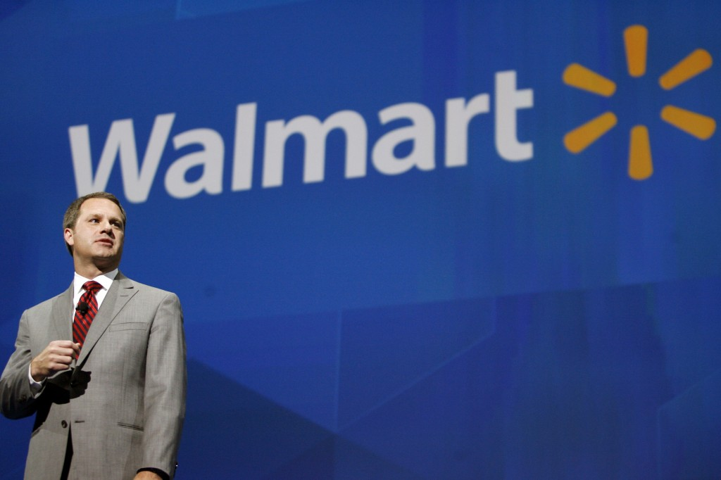 Doug McMillon speaks at the Walmart shareholders meeting in Fayetteville, Ark., in this June 7 photo. The discount chain has alienated some U.S. shoppers because it doesn't have enough workers to keep shelves adequately stocked, leading some consumers to decamp to smaller-format stores that offer merchandise starting at $1.