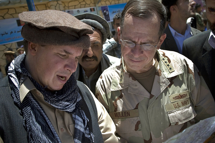 In this 2009 file photo released by Department of Defense, author Greg Mortenson (left) shows the locations of future village schools to U.S. Navy Adm. Mike Mullen, at the opening of Pushghar Village Girls School 60 miles north of Kabul in Panjshir Valley, Afghanistan.