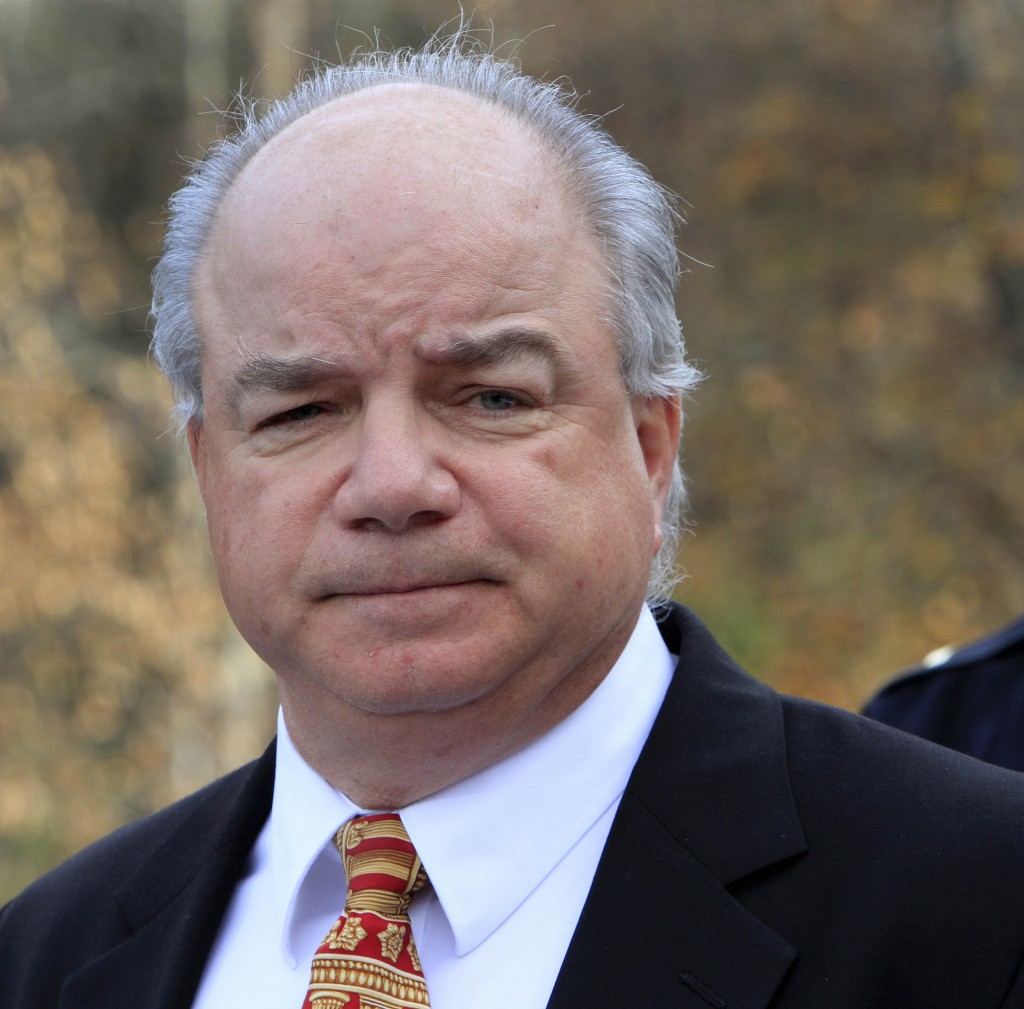New Hampshire's Rockingham County Attorney Jim Reams, shown in a 2012 photo, is ordered off the job and Deputy Tom Reid is put on paid administrative leave.