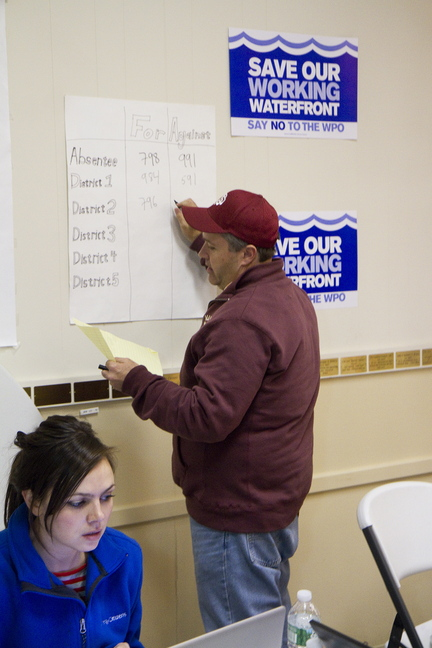Working Waterfront Coalition campaign manager Dan Demeritt tallies poll results.