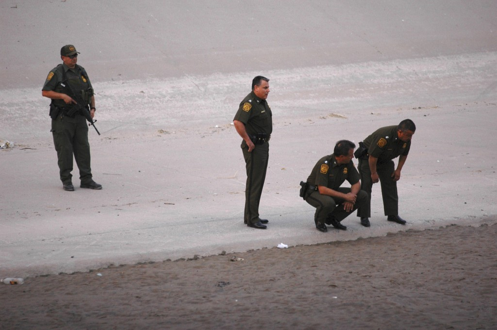 In this June 7, 2010, photo, border patrol agents examine the area near where 14-year-old Mexican youth Sergio Adrian Hernandez Huereca was killed, allegedly shot by a U.S. Border Patrol agent after a confrontation under the Paso Del Norte border bridge in Ciudad Juarez, Mexico.