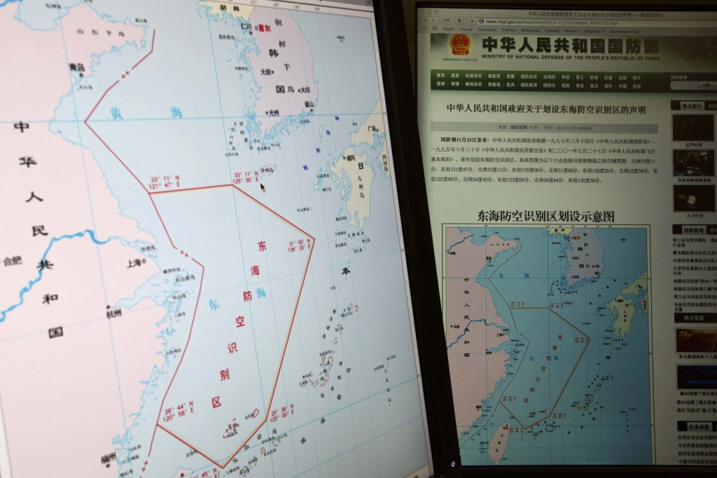 Computer screens display a map showing the red outline of China's new air defense zone in the East China Sea on the website of the Chinese Ministry of Defense. Beijing said all aircraft entering the area must notify Chinese authorities and are subject to emergency military measures if they do not identify themselves or obey Beijing's orders.