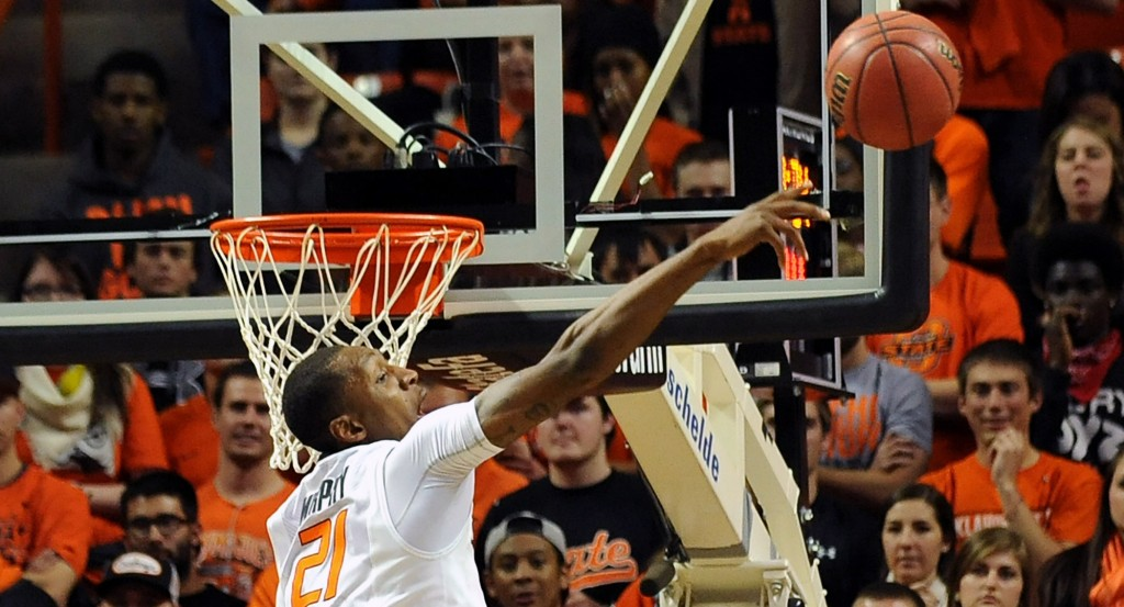 Kamari Murphy of Oklahoma State blocks a Memphis shot during the first half of a matchup between top teams at Stillwater, Okla.. on Tuesday. Oklahoma State, however, turned it into a runaway as Marcus Smart scored 39 points in a 101-80 win.