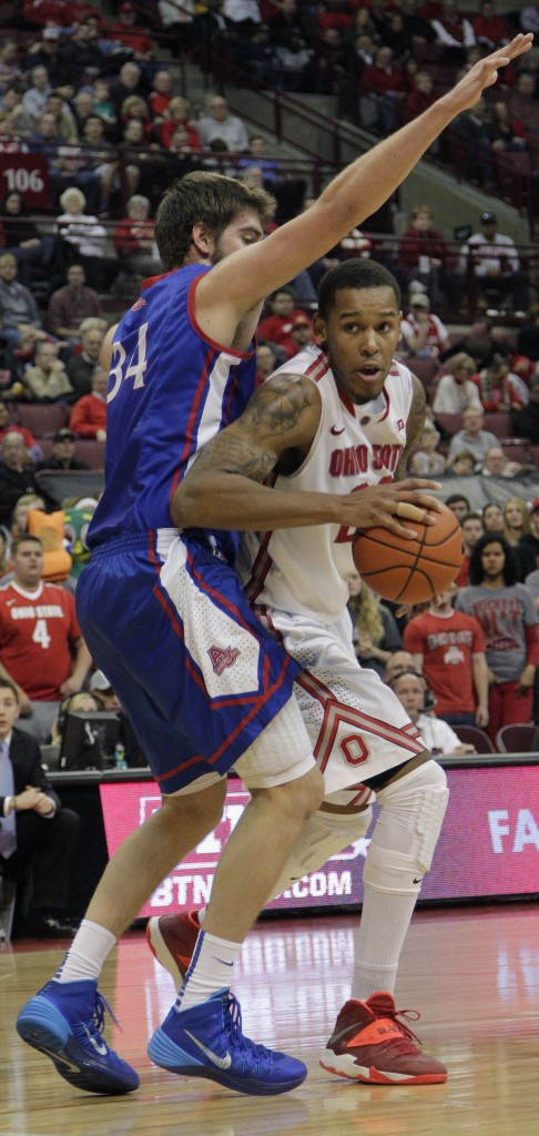 Ohio State's Amir Williams, right, tries to dribble past American University's Tony Wroblicky during Wednesday's game in Columbus, Ohio.