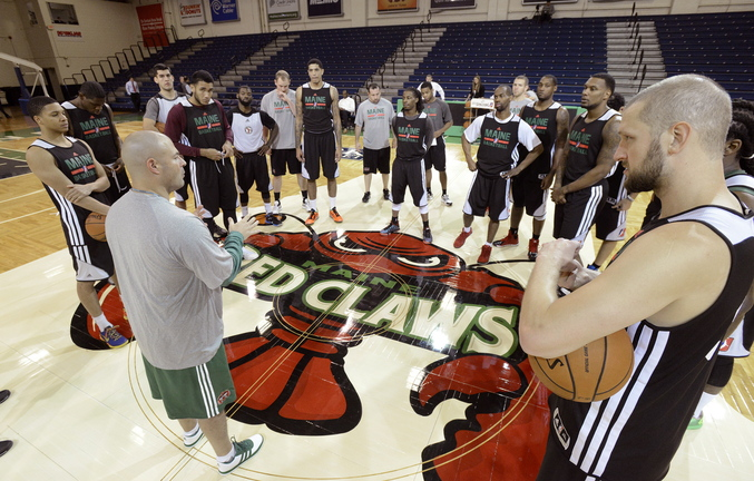 Coach Mike Taylor of the Maine Red Claws has 17 players at center court at the Portland Expo for practice. Soon those 17 players will become 10 as the Red Claws undergotryouts while preparing for the Nov. 22 opener against the Springfield Armor at the Expo.