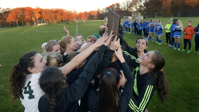 Waynflete celebrates with the trophy after winning the Western Class C title, and will be looking for another trophy Saturday when it meets Orono in the state final at Hampden.