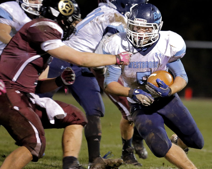 Kyle Heath looks for a way past Sam Peck of Greely in the first half of their Western Class B quarterfinal Friday night. Westbrook atoned for an earlier loss to the Rangers, scoring a 26-19 victory.