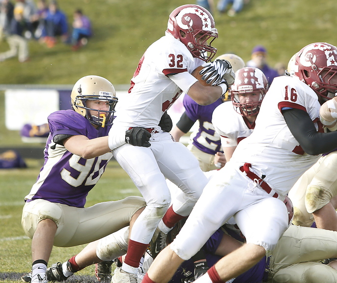 Zordan Holman of Cheverus slows Dane Johnson of Bangor during Cheverus' 37-0 victory Saturday in an Eastern Class A semifinal. The Stags will meet Portland in the final.