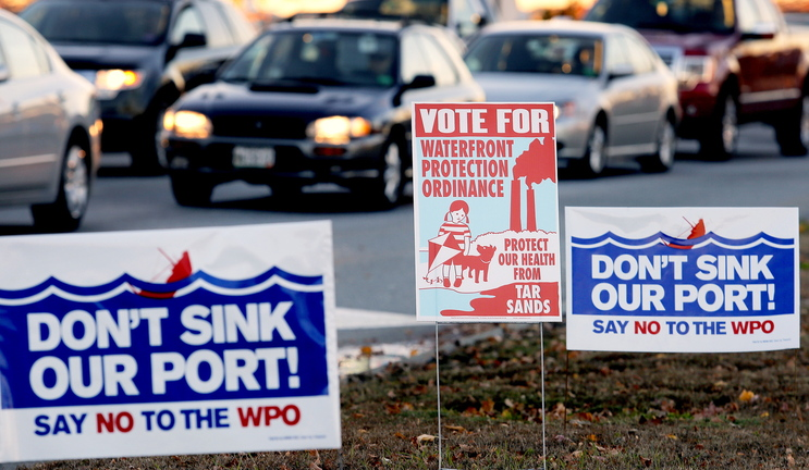 Campaign signs for and against a proposed waterfront ordinance in South Portland dot the median near the Casco Bay Bridge on Monday, a day before the election.