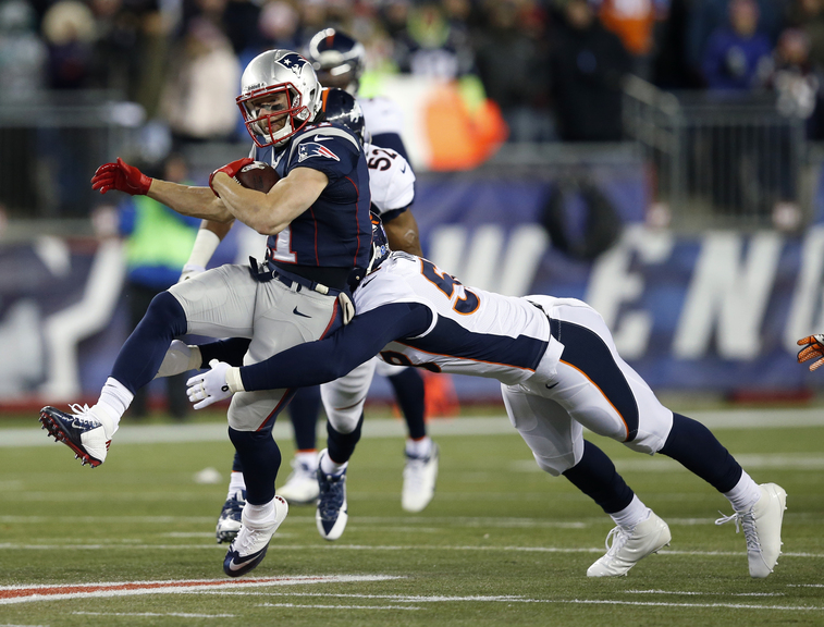 Broncos linebacker Von Miller tackles Patriots wide receiver Julian Edelman in the first quarter Sunday.
