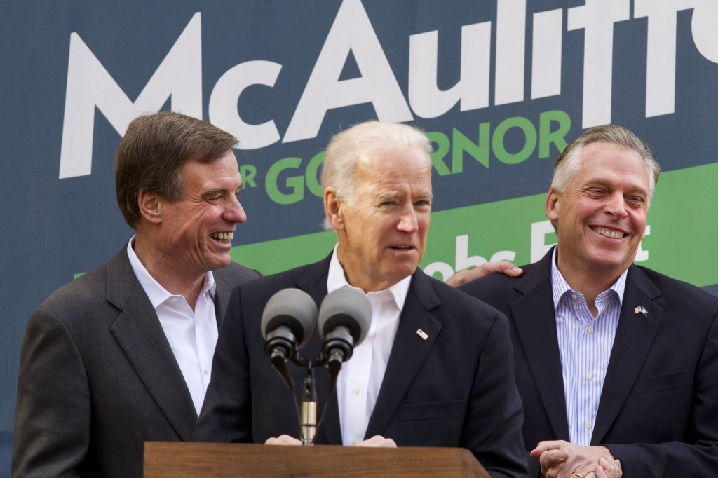 Vice President Joe Biden, center, accompanied by Sen. Mark Warner, D-Va., left, speaks at a campaign event for Virginia Democratic gubernatorial candidate Terry McAuliffe, right, on Monday in Annandale, Va. On Tuesday, Virginia voters go to the polls to choose between McAuliffe and Ken Cuccinelli for the next governor.