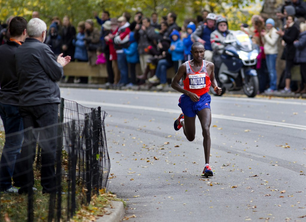 Geoffrey Mutai of Kenya rounds a corner in Central Park on his way to winning the New York Marathon Sunday, Nov. 3, 2013. The New York City Marathon returned after a one-year absence with big crowds and heightened security.