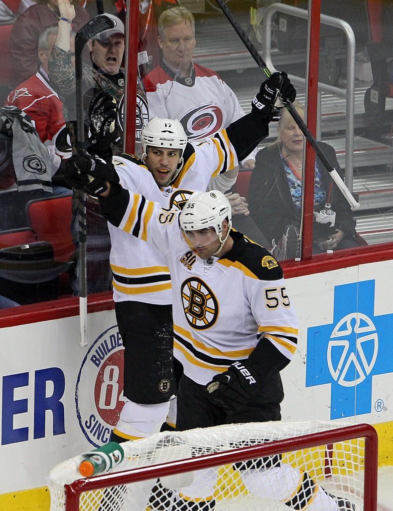 Milan Lucic and Johnny Boychuk celebrate Boychuk's third-period goal Monday night at Raleigh, N.C. The Bruins beat the Carolina Hurricanes, 4-1.