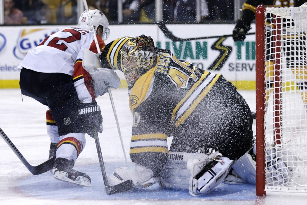 Goaltender Tuukka Rask makes a save against Florida Panthers forward Kris Versteeg during Thursday night's game in Boston.