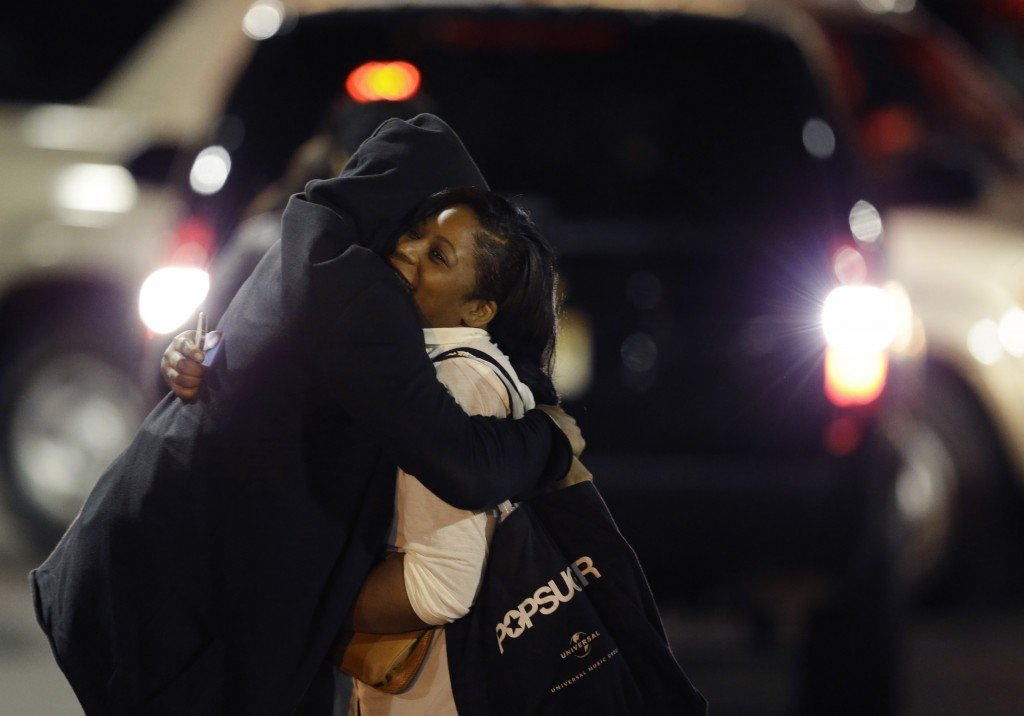 A woman is reunited with a man in the parking lot of Garden State Plaza Mall on Tuesday morning.
