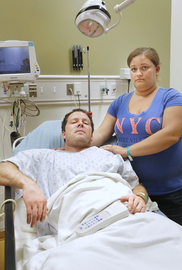 Casey Larcombe and his fiancee, Kathryn LePage, await results of X-rays on Larcombe's spine at Maine Medical Center on Nov. 7. A reader wonders how anyone can believe that the driver who allegedly triggered a crash involving Larcombe on Nov. 6 was unaware that she'd hit his car.